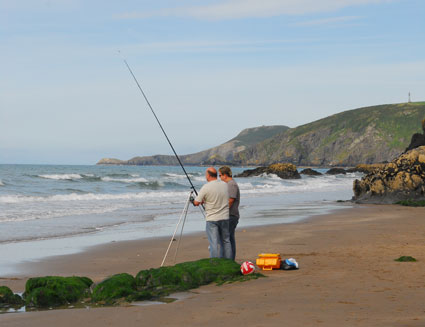 Fishing from the beach at Tresaith